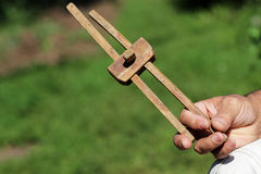 Old tool. Old wooden tool for measuring a man's hand Stock Photo