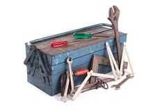 Old toolbox filled with vintage tools stock photography