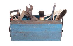 Old toolbox filled with vintage tools. Isolated royalty free stock image