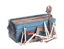 Old toolbox filled with vintage tools. Isolated stock images