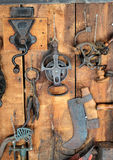 Old tools. On a wall in a barn Stock Photo