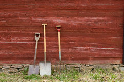 Old tools. Old garden tools at an old barn wall Royalty Free Stock Images