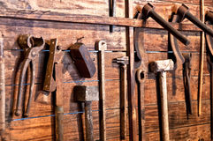 Old tools. On a wooden board stock photo