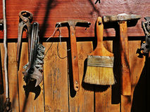 Old tools. Paint brush & hammers on wooden wall Royalty Free Stock Photos