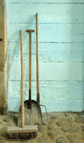 Old tools. By an old wall Royalty Free Stock Photo