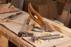 Old tools. Old carpentry tools on a work bench Stock Image