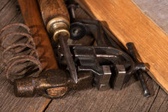 Old tools. On wooden table still-life royalty free stock image