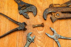 Old tools. Old tools close-up on a background of wooden planks Royalty Free Stock Image