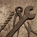 Old tools. Rusty old tools on rusty sheet metal background royalty free stock images