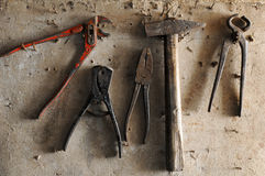 Old tools. Hanging on old wooden wall stock photography