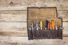 Old tools in bag. On wooden background. Top view Royalty Free Stock Photography