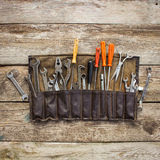 Old tools in a bag. On wooden background. Top view Stock Images