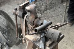 Old tools and vise in blacksmith workshop stock photos