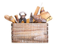 Old tools in a box. Isolated on white background Stock Images