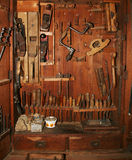 Old tools cabinet. Very old and worn woodworking tools in worn down cabinet Stock Images