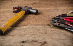 Old tools. Old carpenter tools on wooden background,rust pliers stock photo