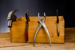 Old tools. Old carpenter tools on wooden background,rust pliers royalty free stock photography