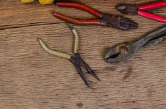 Old tools. Old carpenter tools on wooden background,rust pliers royalty free stock photo