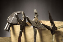 Old tools. Old carpenter tools on wooden background,rust pliers stock photos