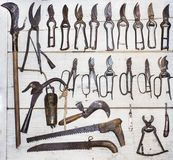 Old tools collection on wooden wall. stock photos