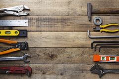 Old tools equipment with blackboard on wood table background. Engineering concept royalty free stock images