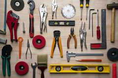 Old tools equipment set on wood table background. Engineering and industry tool concept, flat lay royalty free stock image