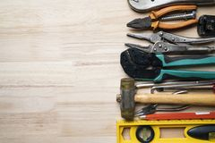 Old tools equipment on wood table background. Engineering concept royalty free stock photography