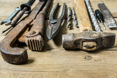 Old tools on wooden background Stock Photos