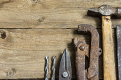 Old tools on wooden background Stock Photography