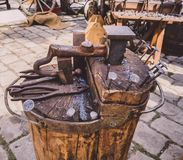 Old tools for handwork and a small anvil . Old tools for handwork and a small anvil of the old era royalty free stock photos