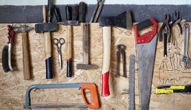 Old tools. Hanging on rack royalty free stock photography