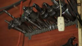 Old tools hanging on wall in workshop stock footage