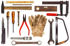 Old tools isolated on white. Various old craftsman tools isolated on white background royalty free stock photos