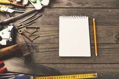 Old tools with notebook with blank pages Royalty Free Stock Images