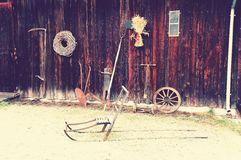Old tools and objects. In front of an old wooden storage building. Building in an old foundry in Baerum Verk. Vintage look from HDR photo. Norwegian winter Royalty Free Stock Photo