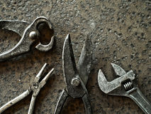 Old tools. Over rusty metal background royalty free stock image