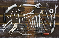 Old Tools. Overhead view. Overhead view of an assortment of old tools on rustic wood background Stock Images