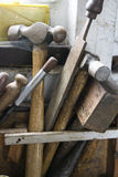 Old Tools in rack on workbench Stock Photography