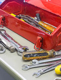 Old tools and red tool box Royalty Free Stock Image