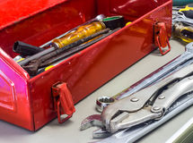 Old tools and red tool box Stock Photo