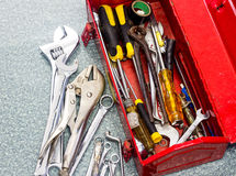 Old tools and red tool box Royalty Free Stock Photos