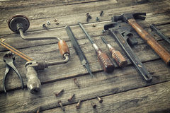 Old tools on rough wood surface Royalty Free Stock Image