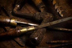 Old tools scattered on a bench Stock Photography