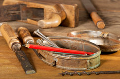 Old tools. Still life with old tools and nails royalty free stock photo