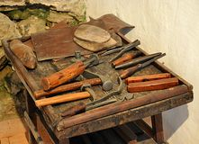 Old tools on the table. View of old tools on the table stock photo