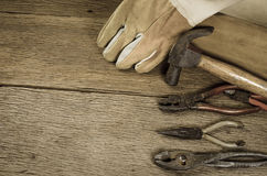 Old tools with tool box. Old carpenter tools on wooden background,rust pliers royalty free stock image