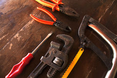 Old tools. Old used dirt tools on wood stock image