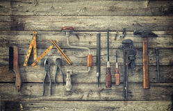 Old tools viewed from above on rough wood surface stock image