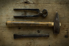 Old tools. Old vintage retro used tools on wooden table royalty free stock images