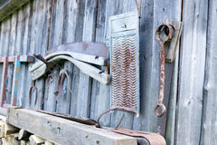 Old tools on a wall. Old tools on wooden wall of a barn Stock Photos